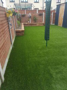 house wall with bermoda grass